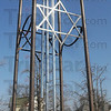 Tribune-Star/Jim Avelis<br /> Tall attraction: The wind chimes on East Main Street in Casey bear the Christian Ichthus on the north and south with the Star of David gracing the east and west sides.