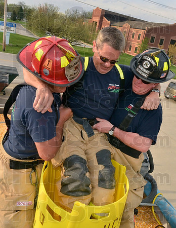 Tribune-Star/Joseph C. Garza<br /> How it's done: After securing panel walls around him, Honey Creek Fire Department Battalion Chief Chris Lynch and firefighter Barry Lilley lift fellow firefighter Terry Clinkenbeard out of the grain rescue tube during a demonstration Thursday at Station 91.