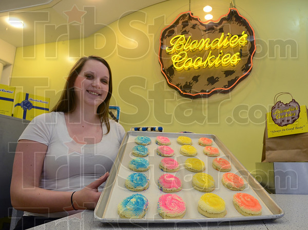 Tribune-Star/Jim Avelis<br /> Sweet stuff: Blondie's manager Barbie Fox holds a tray of cookies in the Honey Creek mall store. The locally grown business will be featured on ABC's Shark Tank