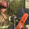 Tribune-Star/Joseph C. Garza<br /> Walls can cut through walls: Honey Creek Fire Department Lt. Mike Walls uses the department's new Husqvarna K12 saw to demonstrate its capabilities Thursday at Station 91.
