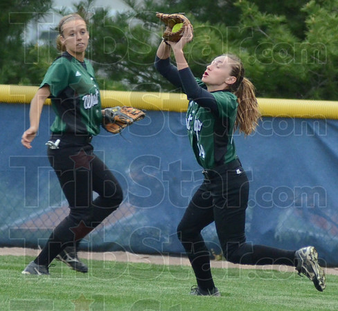 Tribune-Star/Jim Avelis<br /> On the fly: West Vigo right fielder Baylee Waters brings in a fly ball while center fielder Kenzie Little backs her up.