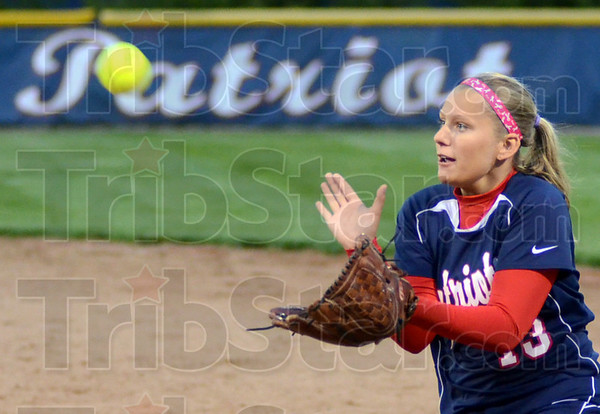 Tribune-Star/Jim Avelis<br /> Well in hand: Terre Haute North second baseman Hailee Travioli eyes a fly ball in the Patriots win over visiting West Vigo Thursday night.