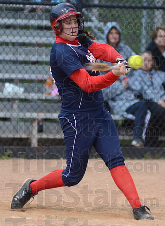 Tribune-Star/Jim Avelis<br /> Knock it around: Terre Haute North's Adrienne Pritchard gets an RBi in teh Patriot's game with visiting West Vigo.