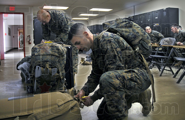Deployment: Lt. Col. Van Riper (L) and 1st Sgt. Anthony Loftus record weight information for their gear as the unit prepares for an Eastern Europe deployment for training.