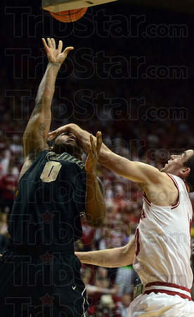Clobberin' time!: Purdue's Terone Johnson takes a forearm across the forehead from Indiana's Will Sheehey during the Hoosiers' game against the Boilers Sunday in Bloomington.