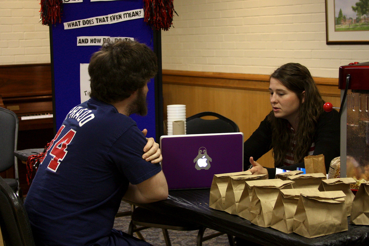 Stephanie Richey talks to senior Adam Barnes about volunteering at Wednesday's Senior Disorientation Fair