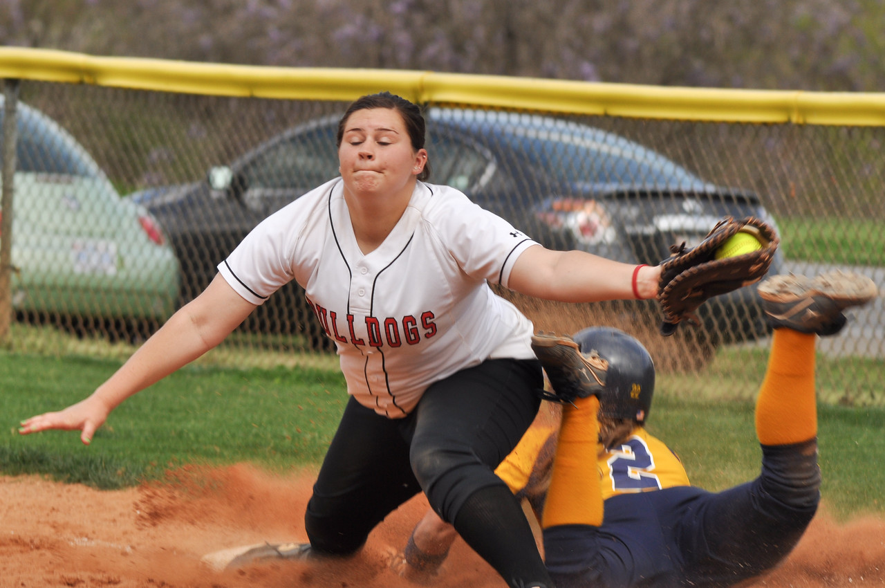 Morgan Baker cathes at first vs UNC Greensboro on March 22, 2012.