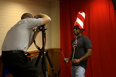 A GW Senoir grabs some props and gets his photo taken at Wednesday's Senior Disorientation Fair