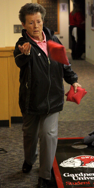 Dee Hunt plays some corn hole during Wednesday's Senior Disorientation Fair