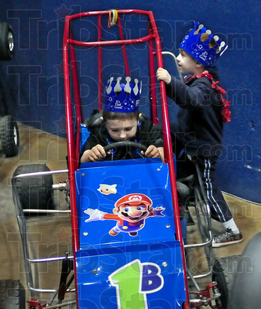 Mario brothers: Brothers Dakota and Easton Roberts enjoy playing on a Mario Brothers race car during Friday's opening of the annual Home Show.
