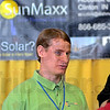 Solar man: Seth Davis of SunMaxx talks with potential customers during the 2012 Home Show at Hulman Center Friday evening.