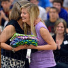 Tribune-Star/Joseph C. Garza<br /> Hugs and cases: Terre Haute North student Lea Zebrowski is hugged by teacher Barbara Lowe-Kraus as she receives a donation of pillow cases made by Lowe-Kraus' students Friday during an assembly at North.