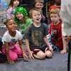 Tribune-Star/Joseph C. Garza<br /> Could it really be?: Students in Susy Phillips' Kindergarten class at Sugar Grove Elementary School stare in wonder at a visiting leprechaun a.k.a. Pat Sheehan upon his arrival in their classroom Friday morning at the school.