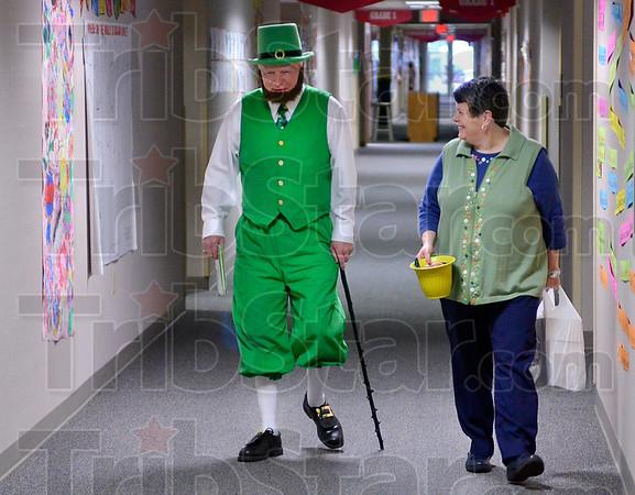 Tribune-Star/Joseph C. Garza<br /> A leprechaun roams these halls: Vigo County School Board member Pat Sheehan walks to Kindergarten class at Sugar Grove Elementary with Principal Gail Artis Friday to visit the students in the class.