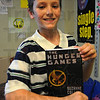 Tribune-Star/Jim Avelis<br /> Motivated reader: Sugar Grove student Trevor Ley holds a copy of The Hunger Games in his classroom Friday afternoon.
