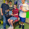 Tribune-Star/Jim Avelis<br /> Growing trend: Many students in Tiffany Scamihorn's class at Sugar Grove Elementary School are reading the Hunger Games series of books. The series about a post-apoctalyptic America is the latest big fad in reading. These students are Austin Willis, Trevor Ley, Aaron Gentry and Moses Bovenschen.