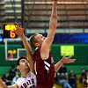 Rose-Hulman's Jason Haslag beats North Central's Vince Kmiec to the basket as he shoots a two-point basket during the Engineers' Div. 3 game against the Cardinals Friday in St. Louis.