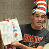 "Tribune-Star/Jim Avelis<br /> In charge: Terre Haute South's Spencer Whitlock reads Dr. Seuss' ""If I Ran the Zoo"" to students at Ouabache Elementary School Friday afternoon."