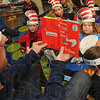 "Tribune-Star/Jim Avelis<br /> Breakfast: Indiana State football player Trent Lancaster reads ""Green Eggs and Ham"" to Ouabache Elementary Schol students as part of the Read Across America"" event."