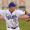 Tribune-Star/Jim Avelis<br /> Out at first: ISU third baseman Ryan Walterhouse throws to first after fielding a ground ball.