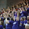 Purple passion: Clay City basketball fans root for their team during Saturday's Regional semi-final game against Hauser.