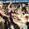 Upset: Terre Haute North's Nathan Jahn celebrates with teammates and classmates after the Patriots defeated Pendleton Heights in the semifinal of the Class 4A regional 46-43 Saturday at Hinkle Fieldhouse in Indianapolis.
