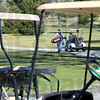 Teed off: Two golfers hit the Rea Park Golf Course to play a round Friday afternoon in chilly temperatures.