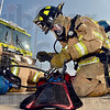 Tribune-Star/Joseph C. Garza<br /> When they have to rescue their own: Honey Creek Fire Department firefighter Mike Shelton demonstrates how a RIT (Rapid Intervention Team) kit is used Thursday at the fire station. The RIT bag contains equipment like air bottles, ropes, hoses and masks to help rescue a fellow firefighter that has fallen in a fire.