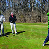 Cool golfers: A foursome of Tony Fears, Dave Thiemann, John Newlin and Pat Walker watch the flight of Walker's ball on the front nine at Hulman Links.
