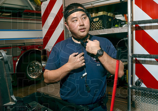 Tribune-Star/Joseph C. Garza<br /> For communication with a mask: Sugar Creek Fire Department Capt. Hidekatsu Kajitani describes Wednesday how a throat microphone operates which is just one of the many tools the department uses in rescue situations.
