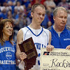 Tribune-Star/Joseph C. Garza<br /> Set the example for others: Rockville's Matt Wheeler smiles through tears for a photo with his parents, Mary-Kay and Ron Wheeler, after he was named the winner of the Arthur L. Trester Mental Attitude Award in Class A boys basketball Saturday in Indianapolis.