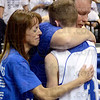 Tribune-Star/Joseph C. Garza<br /> A hug no matter win, lose, or draw: Rockville's Kyle Wheeler receives a hug from his parents, Mary-Kay and Ron Wheeler, after the Rox' state championship game against Loogootee Saturday at Bankers Life Fieldhouse in Indianapolis.