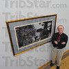 Tribune-Star/Jim Avelis<br /> Favorite: Steve Letsinger stands with one of his favorite works in the Rose-Hulman art collection. The wood block print was given to the school in memory of a former professor.