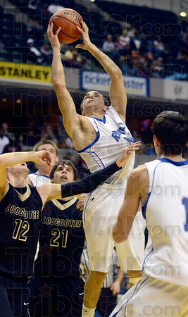 Tribune-Star/Joseph C. Garza<br /> In the Lions' den: Rockville's Joel Wittenmyer grabs one of his three rebounds in the first half of the Rox' state championship game against Loogootee Saturday in Indianapolis.