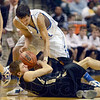 Tribune-Star/Joseph C. Garza<br /> Trying to force turnovers: Rockville's Lane Mahurin tries to steal the ball from Loogootee's Colin Nelson during the Class A state championship Saturday in Indianapolis.