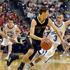 Tribune-Star/Joseph C. Garza<br /> Hot pursuit: Rockville's Lane Mahurin and Kyle Wheeler pursue Loogootee's Colin Nelson to force a turnover during the Class A state championship Saturday in Indianapolis.
