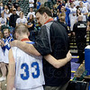 Tribune-Star/Joseph C. Garza<br /> Attitude of a champion: Rockville coach Dave Mahurin walks off the court with Matt Wheeler, the winner of the Arthur L. Trester Mental Attitude Award in Class A boys basketball, after the Rox state championship game against Loogootee Saturday in Indianapolis.