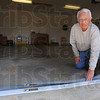 Tribune-Star/Jim Avelis<br /> Easy enough: Elvin Hayes shows how his leaf and debris guard folds over to allow vehicles to pass in and out of a garage using the device.