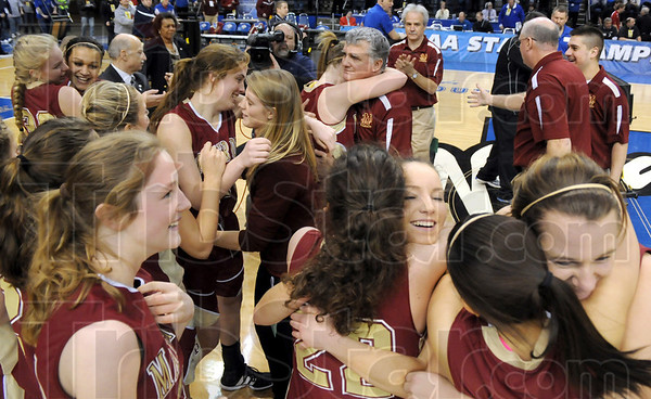 Happy hugs: Evansville Mater Dei players embrace on the court aftern winning the class AA State Championship Saturday afternoon at Hulman Center.