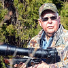Photo hunter: Wildlife photographer Joe Dickson carries his gun stock mounted telephoto lens and camera Sunday afternoon.