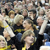 Variety: A group of Mt. Vernon basketball fans react in a variety of ways to an official's call during first half action of the class 3A State Championship game against Ft. Wayne Concordia.