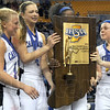 Champs: A group of Ft. Wayne Canterbury players hold the class A State Championship trophy after their victory over Northeast Dubois Saturday at Hulman Center