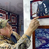 Photos: Wildlife photographer/conservationist proudly displays some of his wildlife photos in his northside home.