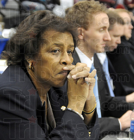 Tourney director:Theresia Wynns watches the action of the IHSAA State Basketball Championship tournament in Hulman Center Saturday evening. She's the tournament director and assistant commissioner for the IHSAA.