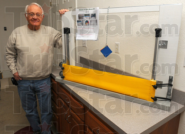 Tribune-Star/Jim Avelis<br /> Traveling example: Elvin Hayes has constructed two models of his leaf guard to take to trade shows. The flexible barrier comes in several different colors.