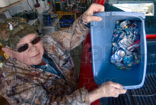 Conservationist: Joe Dickson shows some of his collected aluminum cans he recently picked up from a roadway.