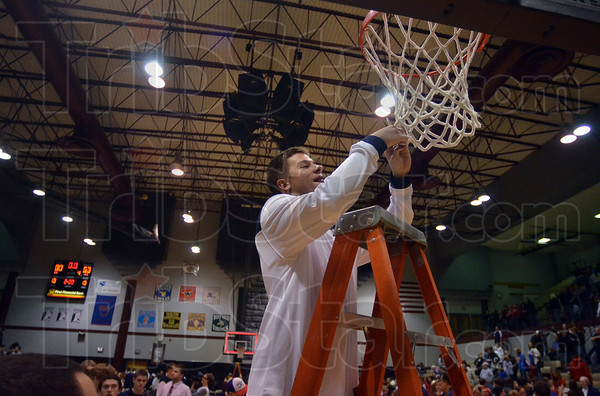 To the victors...net!: Terre Haute North's Adrian Grady cuts his share of the net after the Patriots defeated Mooresville in the sectional championship Saturday at Northview in Brazil.