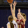 Go ahead: Mater Dei's #31, Maura Muensterman launches and hits the go ahead basket against Ft. Wayne Bishop Luers during the closing seconds of the AA Championship game Saturday afternoon at Hulman Center.