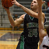 Tribune-Star/Jim Avelis<br /> Open look: West Vigo forward Nathan Gregg gets loose for two past the defense of Edgewood's Tevor Selburg