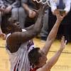 Tribune-Star/Jim Avelis<br /> Over easy: AJ Grady gets a layup despite the defense of Plainfield forward Jon Aldridge.